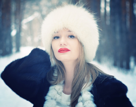 winter portrait of young beautiful woman photo