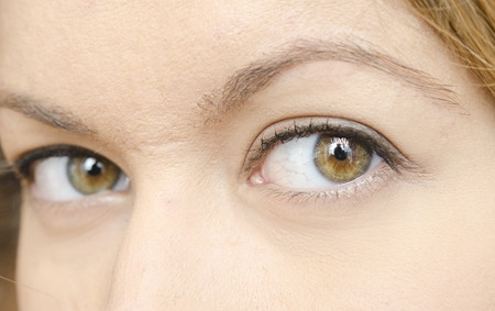 cloee up of woman eyes photo