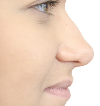 nose close up: close up of face side on white background