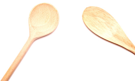 bakeware: two wooden spoons isolated on white background