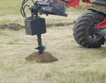 onshore: tractor making a hole