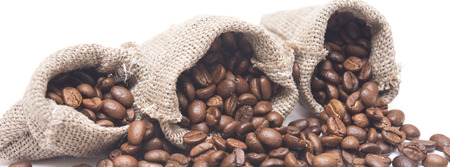 coffee beans in a burlap sack on white background photo