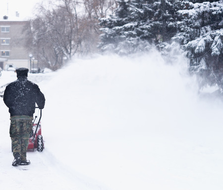 blow: Snow removal with a snow blower Stock Photo