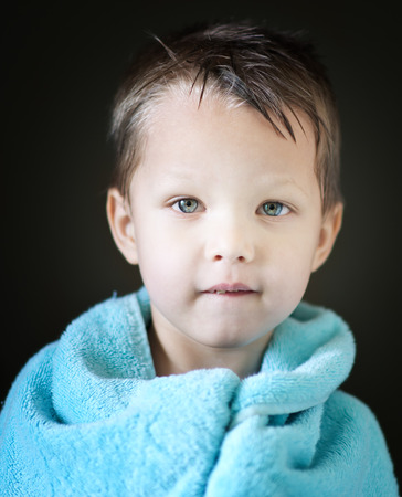 portrait of boy with towel photo