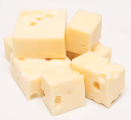 fresh cheese cubes on white plate photo