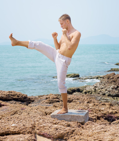 karateka: karateka practicing on the beach Stock Photo