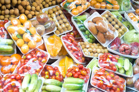 refrigerator with food: fruits and vegetables in packing