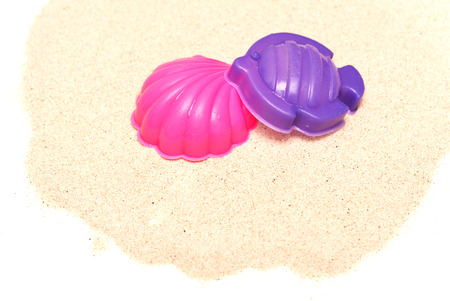 plastic toys: plastic toys on a sand