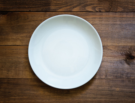 diet dinner: empty plate on a wooden table