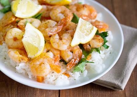 fried shrimps with rice and lemons Stock Photo