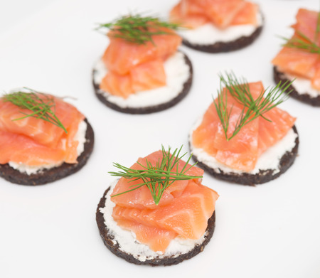 canapes: canapes with cheese and red fish