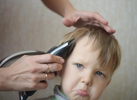 haircut: child getting his haircut Stock Photo
