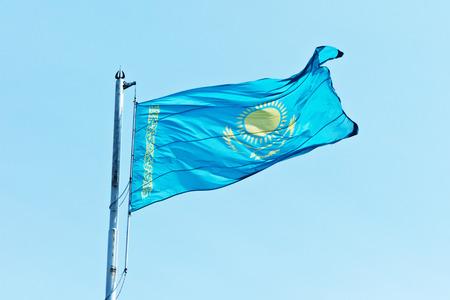 kazakhstan: flag Kazakhstan against blue sky Stock Photo