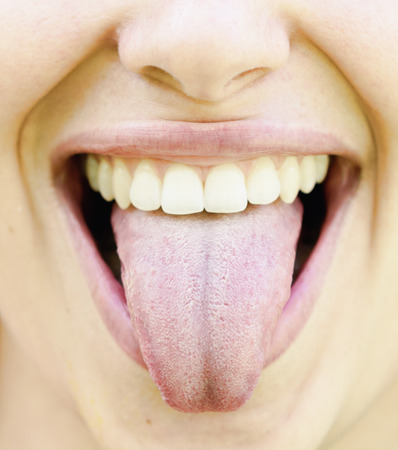 denote: close up shot of woman healthy tongue Stock Photo