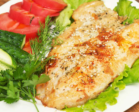 fillets: fried fish with spice and vegetables