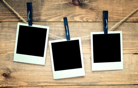 old picture: empty polaroid photo frames on wooden background Stock Photo
