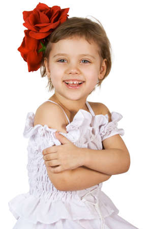 Little smiling girl with red rouses in the hair