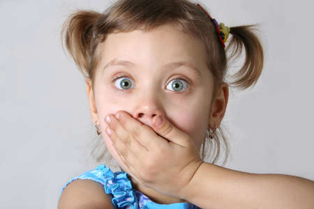 Little afraid girl, gray background