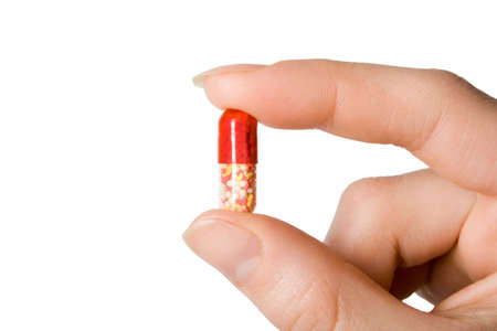 red-white pill in the women hand