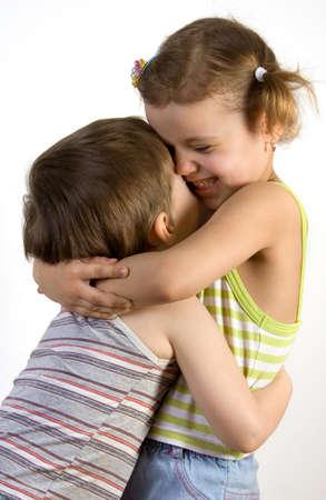 embraces: Smiling girl embraces a little boy