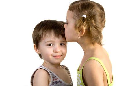 little girl kisses little boy, isolated white background