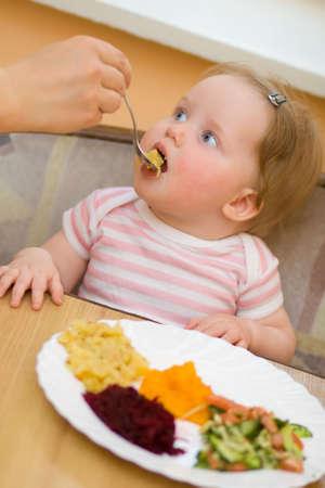 The litle child eats a vegetable salad Stock Photo - 4736878