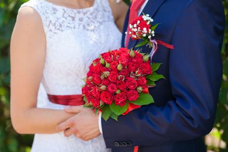 weddings bouquet in the bride and groom hands