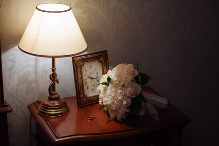 nightstand: wedding rings in box on a nightstand with lamp
