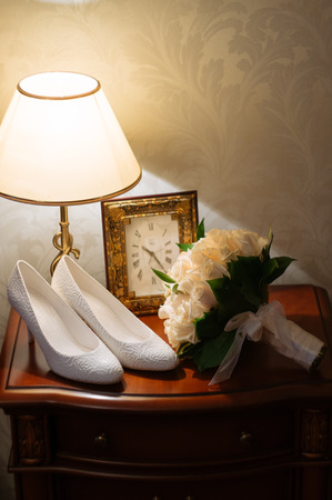 nightstand: wedding bouquet and shoes on the nightstand