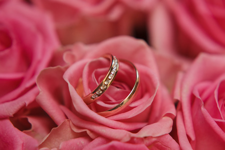 wedding vows: wedding rings and brides bouquet macro shoot