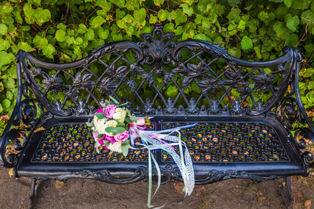 wedding vows: weddings bouquet on the bench in the park