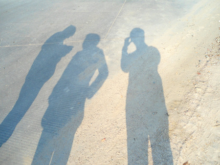 three persons: Shadows of three persons on the floor
