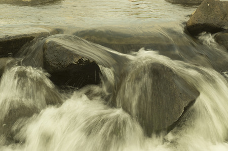 trickle: Water flowing Stock Photo