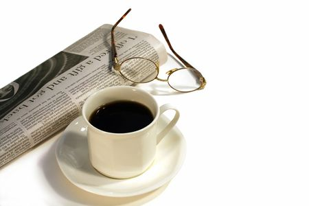 Cup of coffee, newspapers and glasses