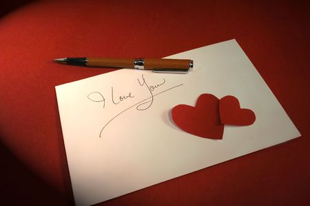 intrigue: Love note on a red background Stock Photo