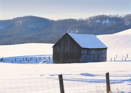 Old weathered barn in the snow photo