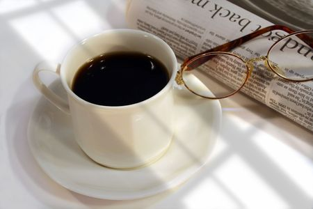 power nap: Morning coffee, newspaper and glasses