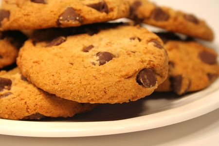 cooky: Chocolate chip cookies on a white plate