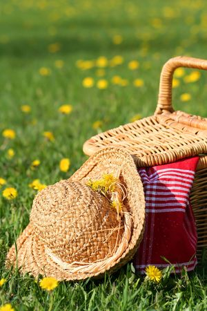 Picnic basket and hat Stock Photo