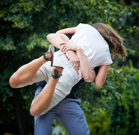 Young man holding his girlfriend in the air photo