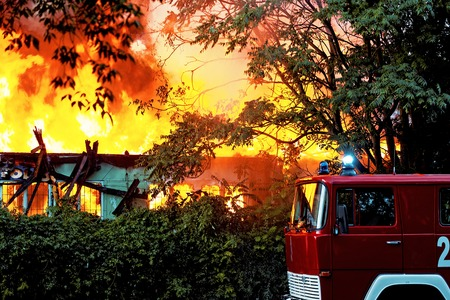 Burning ruins of building in city photo