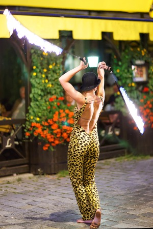 Firedancers performing on street in Wroclaw, Poland