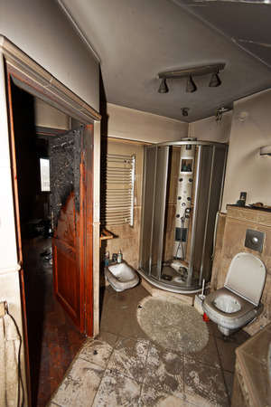 induced: Partly burnt and ruined modern apartment due to short circuit -induced fire, Wroclaw in Poland