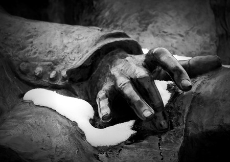 Chopins hand on his lap (statue of Friderick Chopin from Wroc??aw- Poland) photo