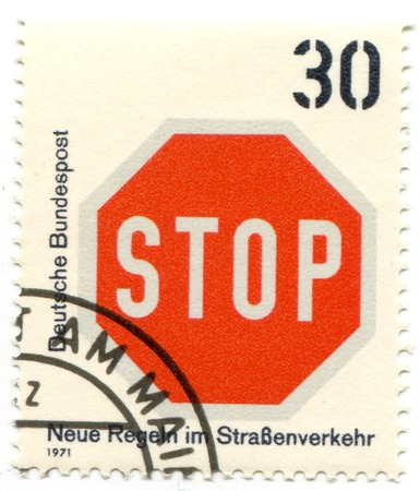 philatelic: Stop road sign on postal stamp
