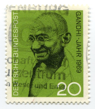 postage stamp printed in Germany showing Mohandas Karamchand Gandhi, circa 2004 photo