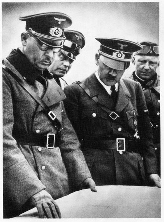 Adolf Hitler among his officers