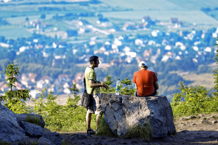 Two men taking a short rest on the top of the mountain in southern Poland photo