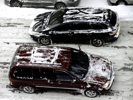 dolnoslaskie: Snow covered cars on street