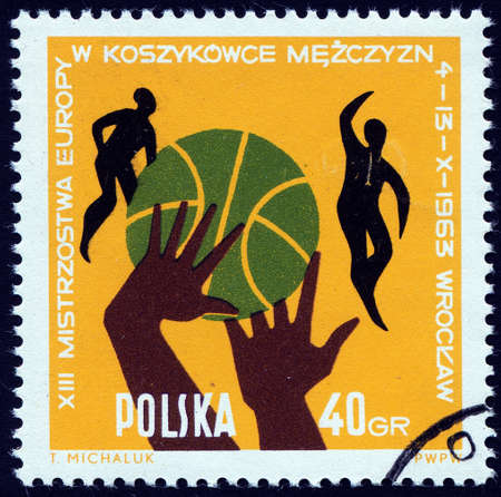 philatelic: Post stamp printed in Poland showing  ball, hands and players, 13th European men basketball championship Wroclaw, circa 1963